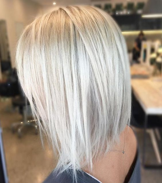 chic textural haircut with icy blonde color