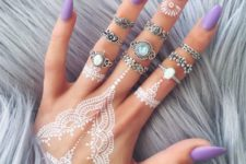 11 lacey white henna tattoo on the hand and fingers