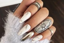 11 long marble nails with an accent silver one