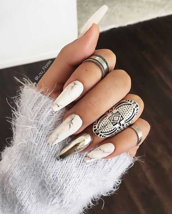 Picture Of long marble nails with an accent silver one