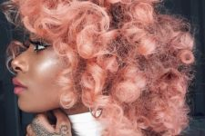 11 natural curls dyed into blorange make a real statement