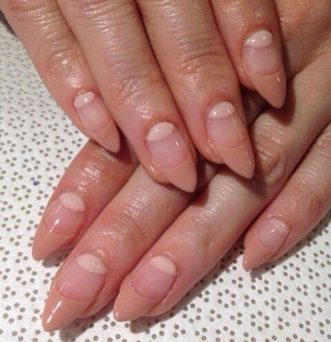 nude negative space nails of an almond shape