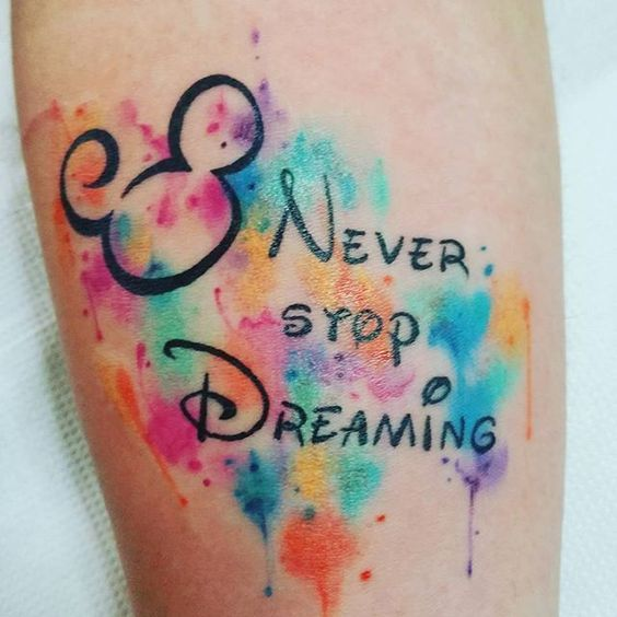 Mickey-inspired tattoo with watercolor touches