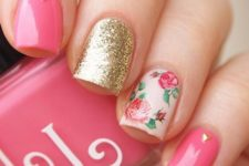 12 bold pink and glitter gold nails with an accent rose one