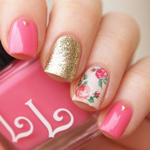 bold pink and glitter gold nails with an accent rose one