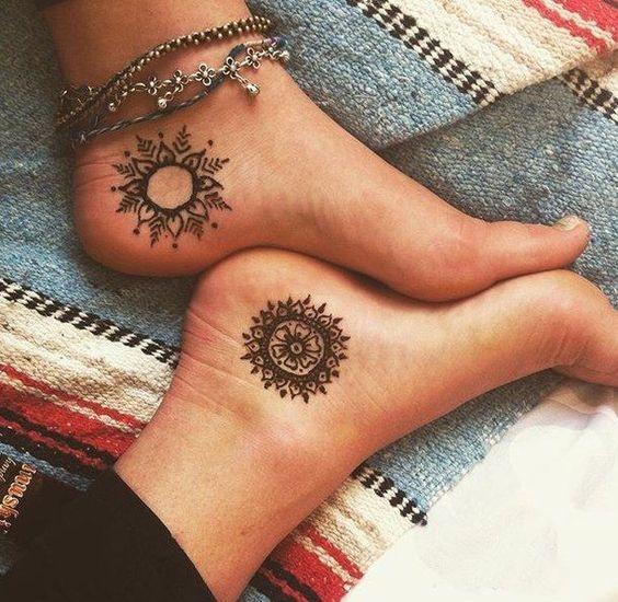 different mandala tattoos on both feet