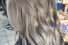 12 dimensional ashy blonde hair with waves