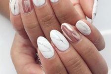 12 marble nails with an accent metallic pink one
