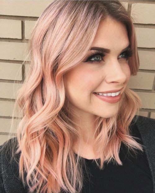 peachy shade of blorange hair, medium length and light waves