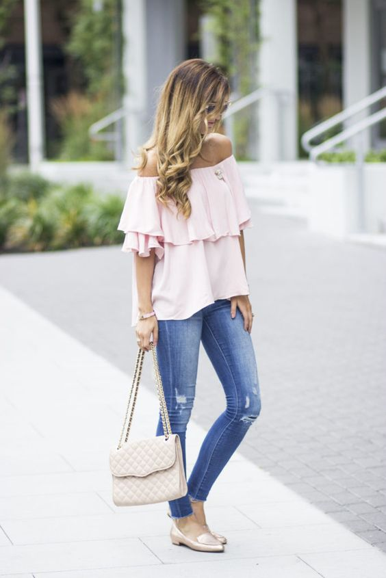 a blush off the shoulder blouse, blue ripped jeans and neutral flats as a perfect spring office look