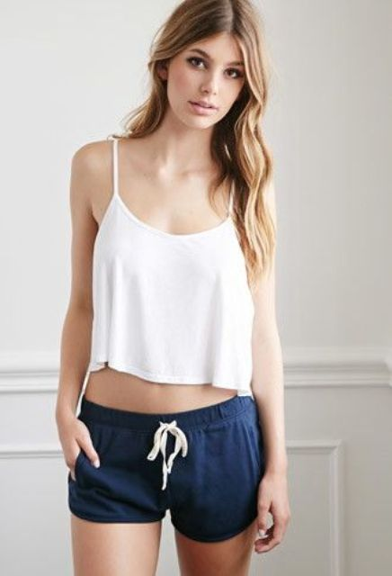 a set of navy shorts and a white spaghetti strap top