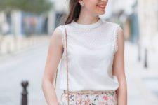 13 a vintage crochet sleeveless top and pastel floral shorts, a nude crossbody