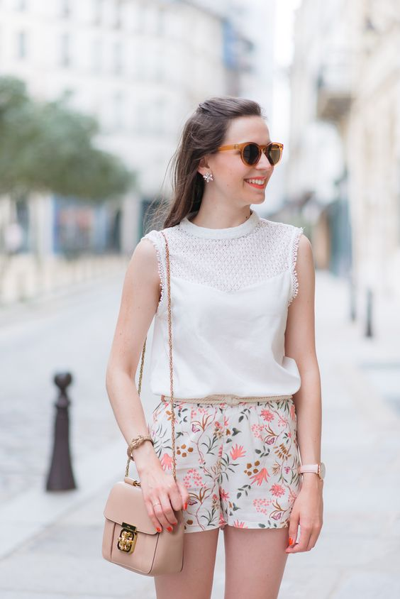 a vintage crochet sleeveless top and pastel floral shorts, a nude crossbody