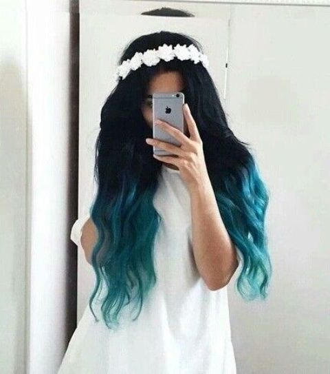 black hair with a teal ombre effect
