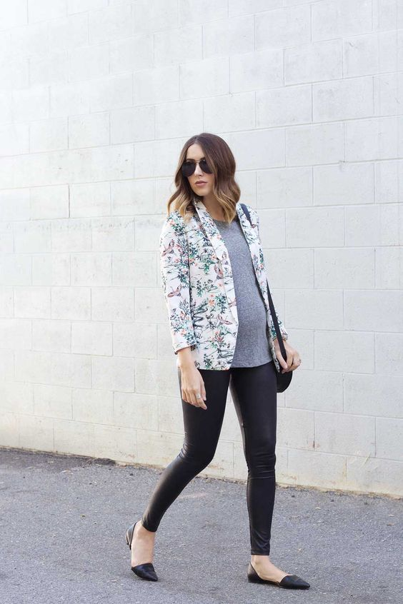 black leather pants, a gree tee, a floral blazer and black flats