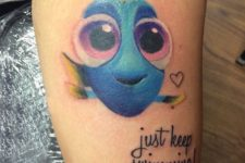 13 bold Dory tattoo with a phrase looks super sweet