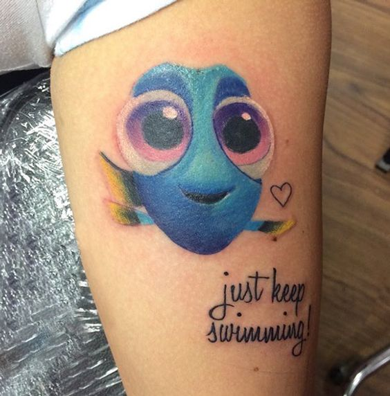 bold Dory tattoo with a phrase looks super sweet