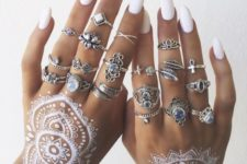 13 large white mandalas on both hands and white nails