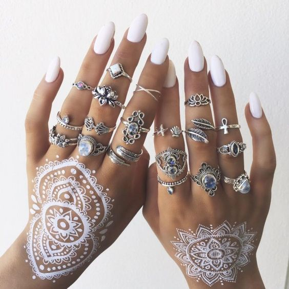 large white mandalas on both hands and white nails