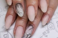 13 matte nude nails with an accent marble one and silver stripes