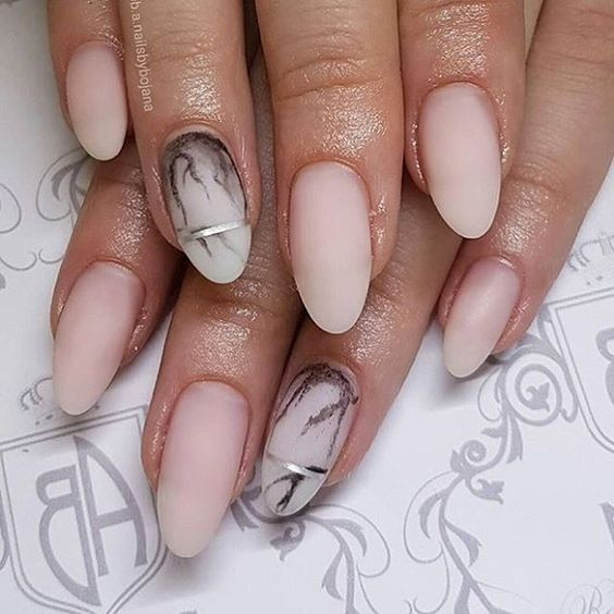 matte nude nails with an accent marble one and silver stripes