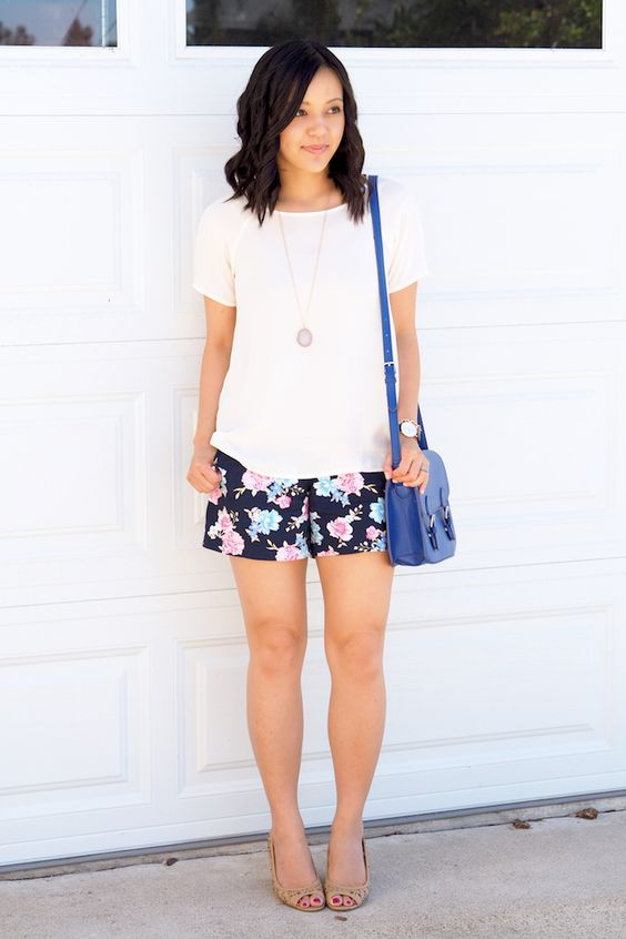 a white tee, black floral shorts and nude peep toe heels