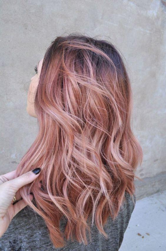 blorange balayage on dark hair looks refreshing and bold