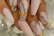 14 matte pink marble nails with accent metallic stripes