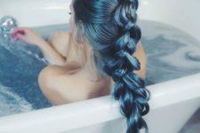14 shiny teal hair in a long braid
