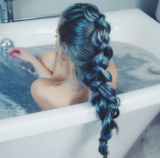 shiny teal hair in a long braid