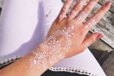 14 the whole hand and wrist covered with beautiful white henna patterns