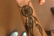 15 a large dream catcher tattoo with feathers