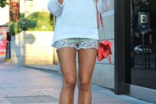 15 colorful floral shorts, a crocheted white top, coral platform shoes and a bag