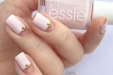15 negative space and white nails with gold beads