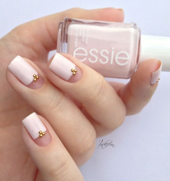 negative space and white nails with gold beads