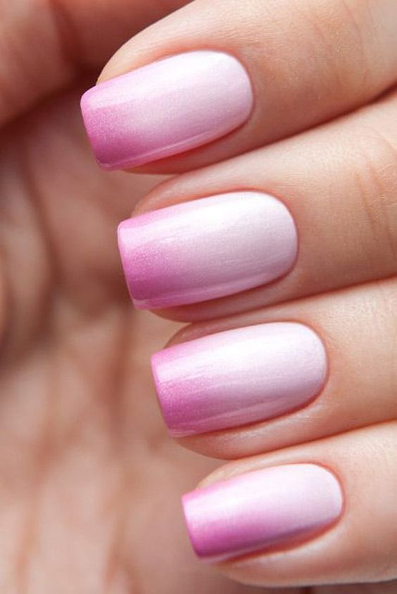 pink ombre nails from bold pink into very light blush