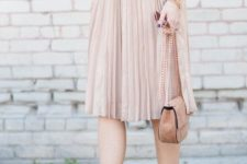 16 a blush pleated skirt and flats, a white tee and a mustard bomber