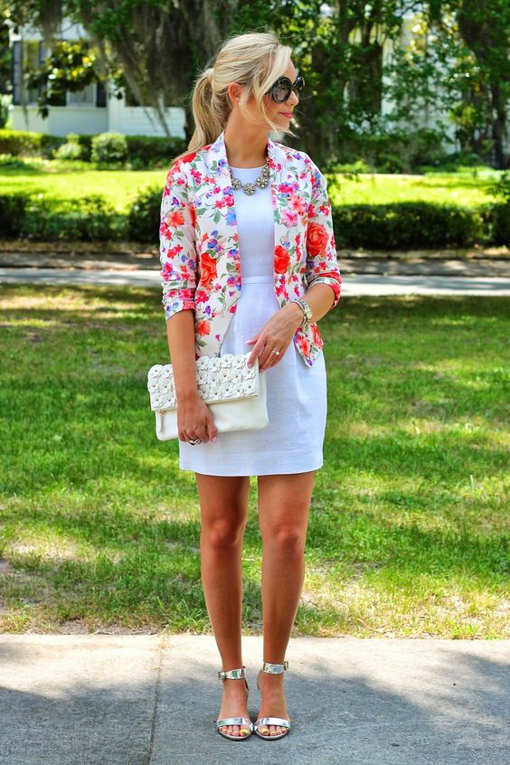 a white mini dress, a bold floral blazer and floral ankle strap shoes