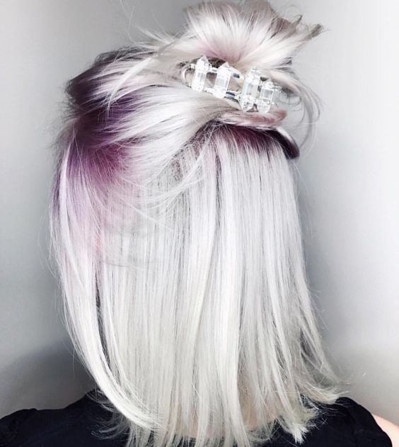icy blonde hair with purple roots will catch everybody's eye