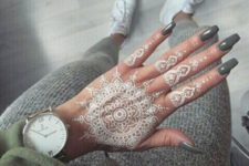 16 white henna tattoo on the hand and all fingers looks wow