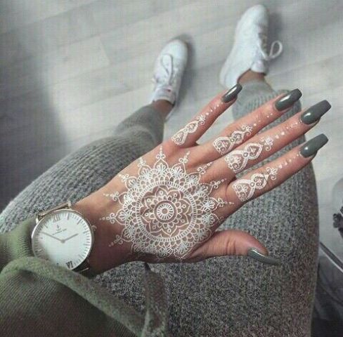 white henna tattoo on the hand and all fingers looks wow