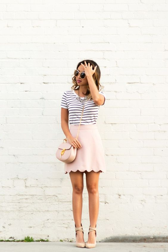 a striped t-shirt, a blush scalloped hem mini skirt and nude lace up heels