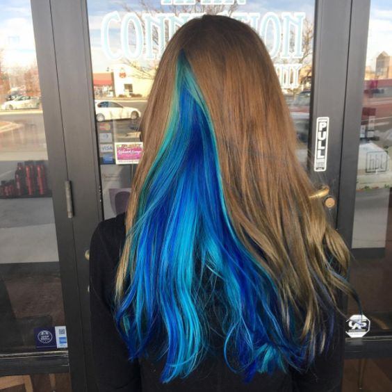 chestnut hair with a bold blue part