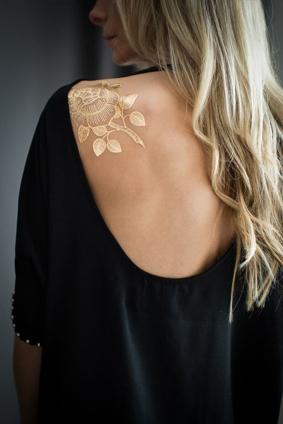 gold henna flower on the back