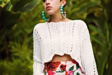 17 high waist floral shorts, a crochet white top with long sleeves and statement earrings