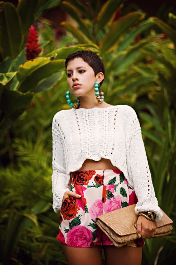 high waist floral shorts, a crochet white top with long sleeves and statement earrings