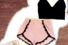 17 pink shorts with a black lace trim and a crop black top