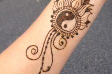 17 symbolic Yin and Yang tattoo on the wrist