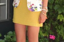 18 a yellow mini dress, a bold floral blazer and white heels
