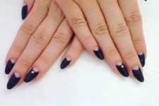 18 dark navy oval almond nails with negative space half moons and small star details